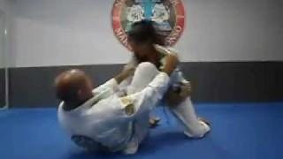 White belt Girl 3 stripes Rolls with second degree black belt
