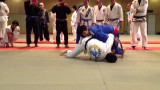 Joao Miyao as a purple belt rolling with a black belt