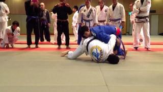 Joao Miyao as a purple belt rolling with a black belt