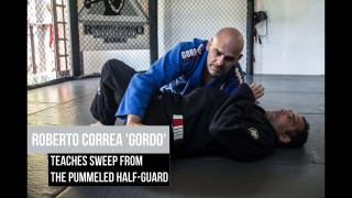 Sweep from the pummeled half guard – Roberto Correa