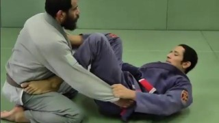 Omoplata counter When Opponent Rolls – Gustavo Carpio