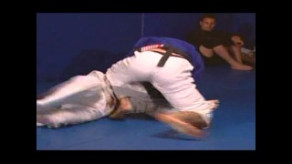 Purple belt Eddie Bravo trying to take Jean Jacques Machado's back and getting denied