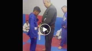 Poor Kid Cries as Instructor Gives him his first Gi