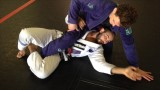 Defending the Kimura from Bottom Half Guard – Bernardo Faria