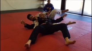 Escaping Omoplata to crucifix – Robson Moura
