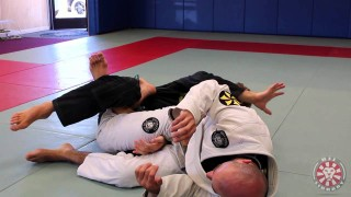 Clark Gracie Rolling Calf Slicer against De la Riva Guard at BJJLIBRARY