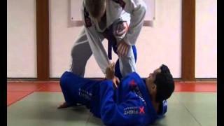 X Guard with foot trip- Vlademir Alves