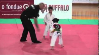 6-year-old girl submitting opponent by choke in competition