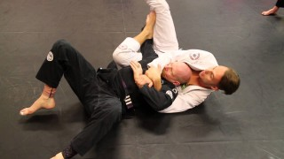 Submitting deep half guard with crucifix position