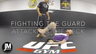 Attacking the neck of the Guard Player