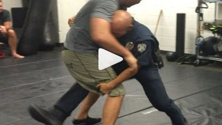 Policemen Work On Grappling