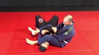 Arm bar defense and attack the back trap – Ricardo Cavalcanti