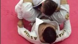 Sneaky Omoplata setup from the Double Under Variation –  Reginaldo Rocha