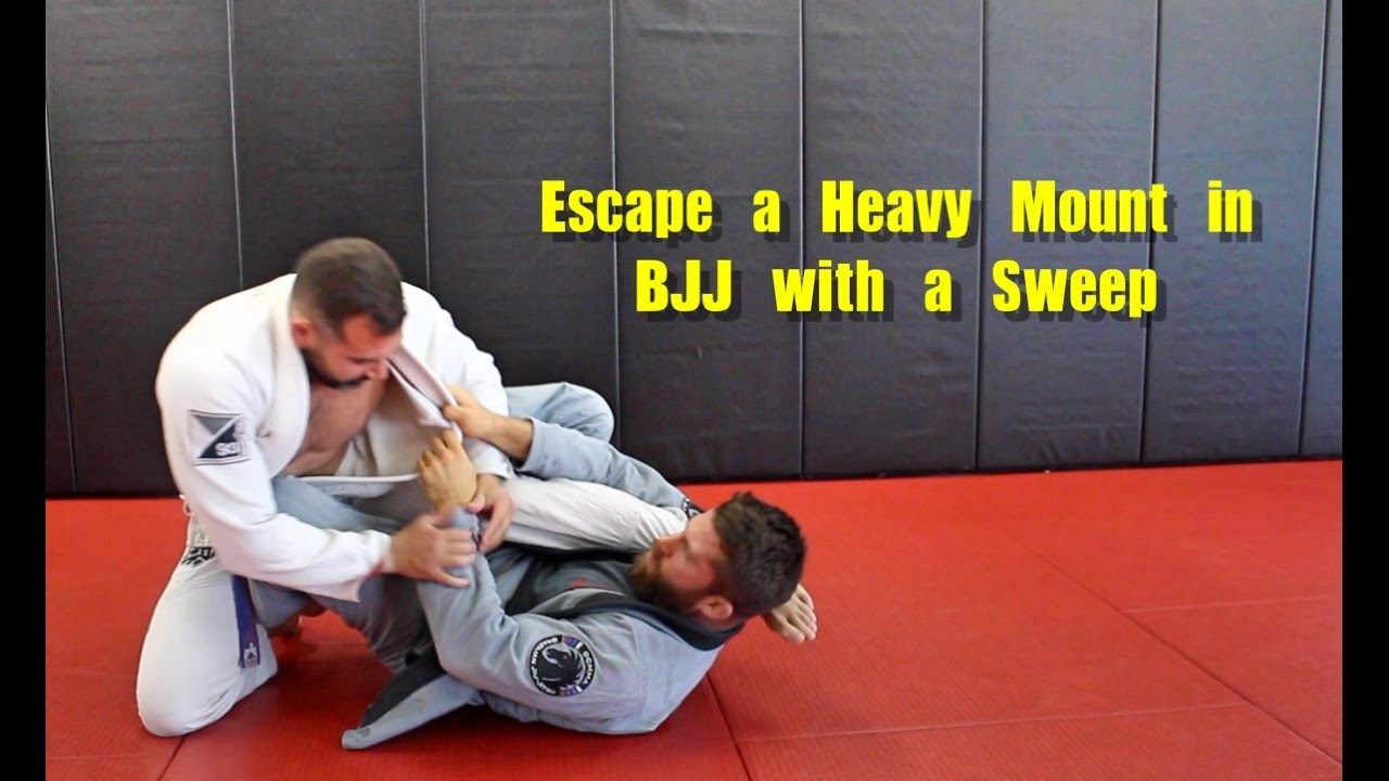 Escape a Heavy Mount in BJJ with a Sweep ( Single X Sweep )