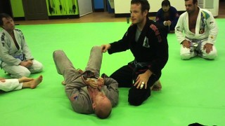 Catching the Kimura grip and finishing a stubborn opponent