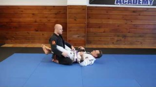 Keeping Your Posture When Standing Up In Closed Guard – Jason Scully