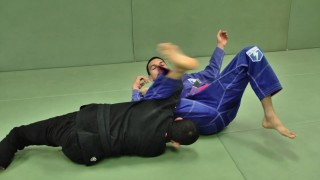 Sitting up guard to X Guard Sweep – Gustavo Carpio