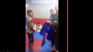 Poor Kid Cries As His Instructor Gives Him His First Gi