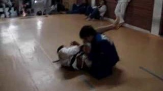A purple belt Gui Mendes rolls with Andre Galvao