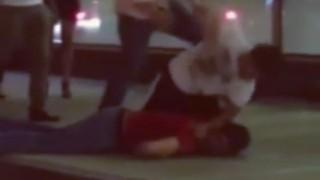 Wrestler Scores a Duck Under Suplex KO in Street Fight