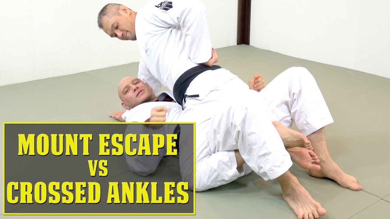 How to Escape Mount When His Ankles Are Crossed Under You?