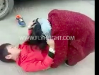 Young Chinese Boy Puts His Mom in Triangle Choke For Trying To Spank Him