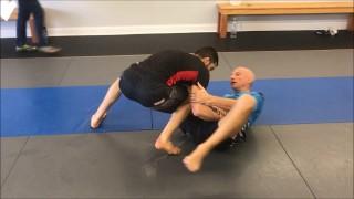 """Armlock from Open Guard by  Renzo Gracie Black Belt Karel """"Silver Fox"""" Pravec"""