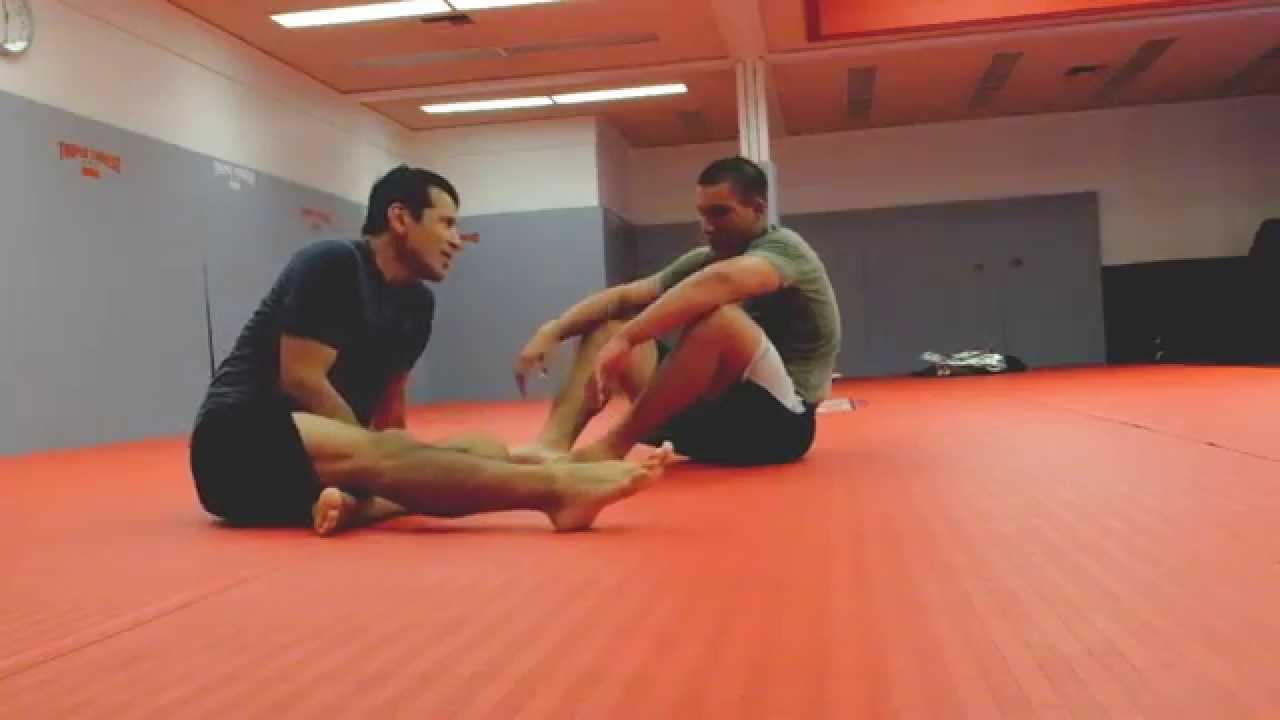 Heavy Blue Belt tries to smash Lighter Older Black Belt