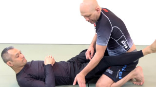 A Small Adjustment to Defend the Kimura Armlock from Guard –