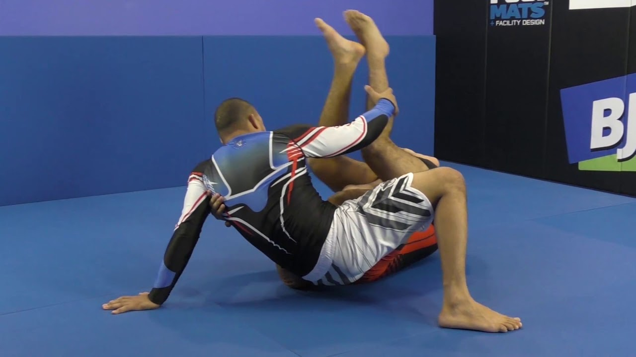 Slide Under Sweep From Reverse Half Guard by Bernardo Faria