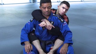 How To Set Up A Triangle Armbar From Back Mount | Evolve