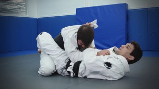 Using The Lapel To Sink in the Armbar- Robson Gracie