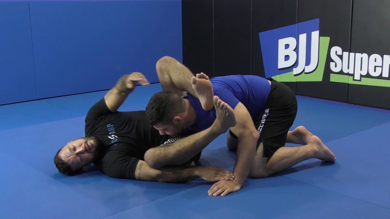 Omoplata To Triangle by Tom DeBlass