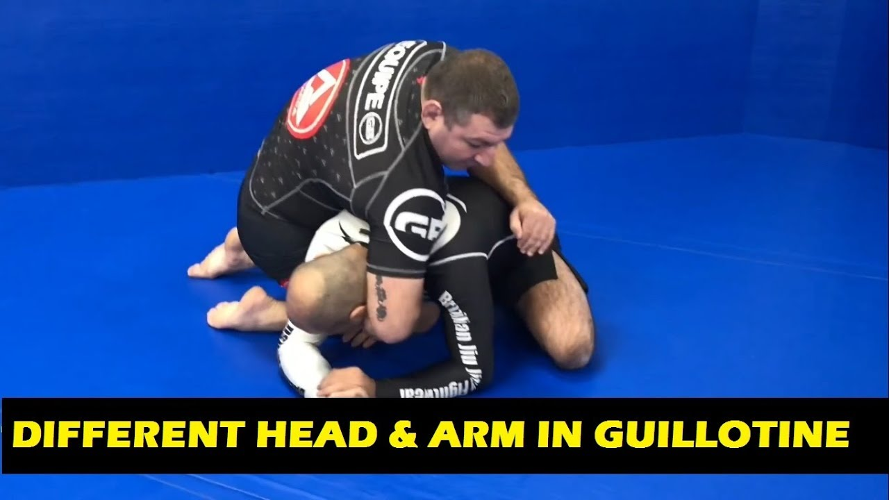Different Head & Arm In Guillotine by Fabiano Scherner