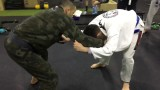 Pulling half guard straight to a sweep