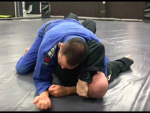 Countering the 'answering the phone' defense to arm triangle with an arm-in Ezekiel choke