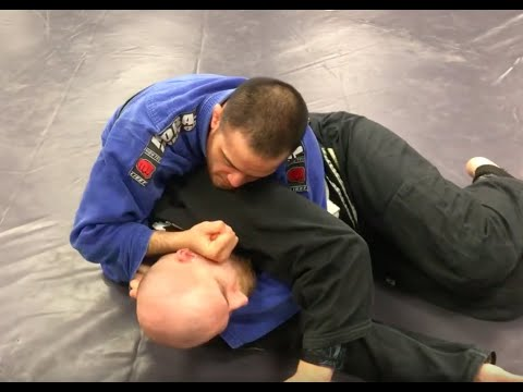Folding pass to arm-in Ezekiel choke from side control