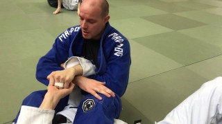 Painful forearm crusher to counter arm lock defense